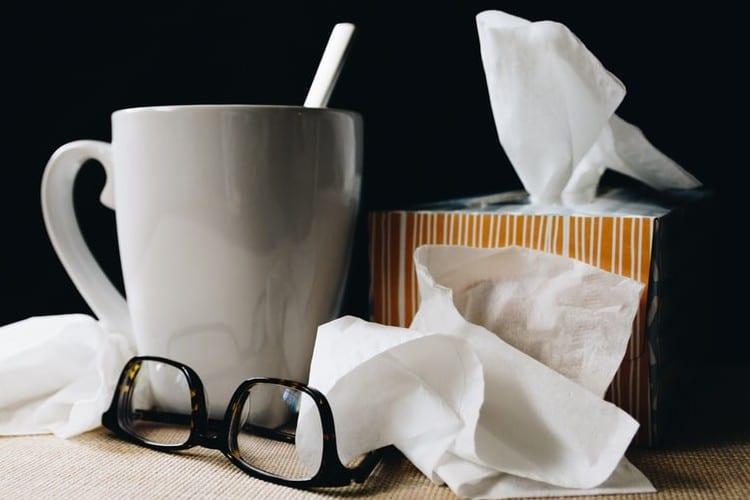 stoppen-met-baan-ik-maak-het-uit-met-mijn-baan-by-kelly-sikkema-white-ceramic-mug-on-white-table-beside-black-eyeglasses
